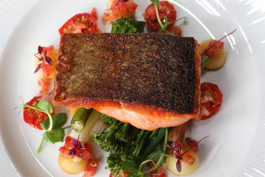 Salmon on a bed of saesonal veg