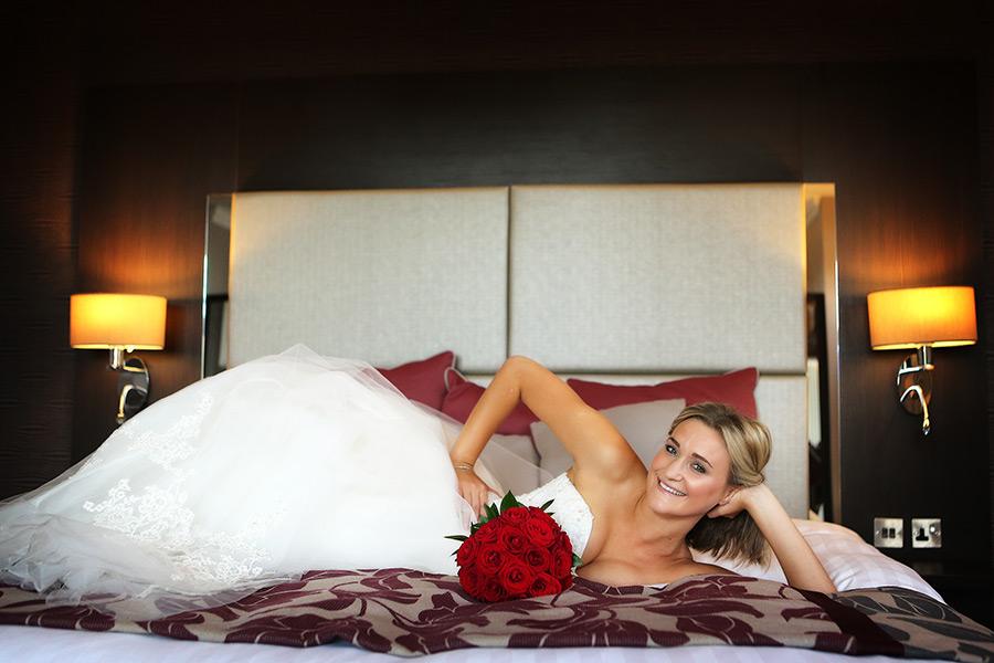 Bride posing on bed