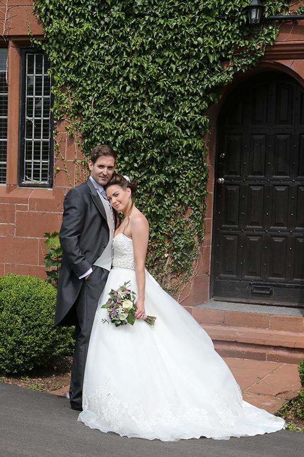 Wedding couple next to ivy