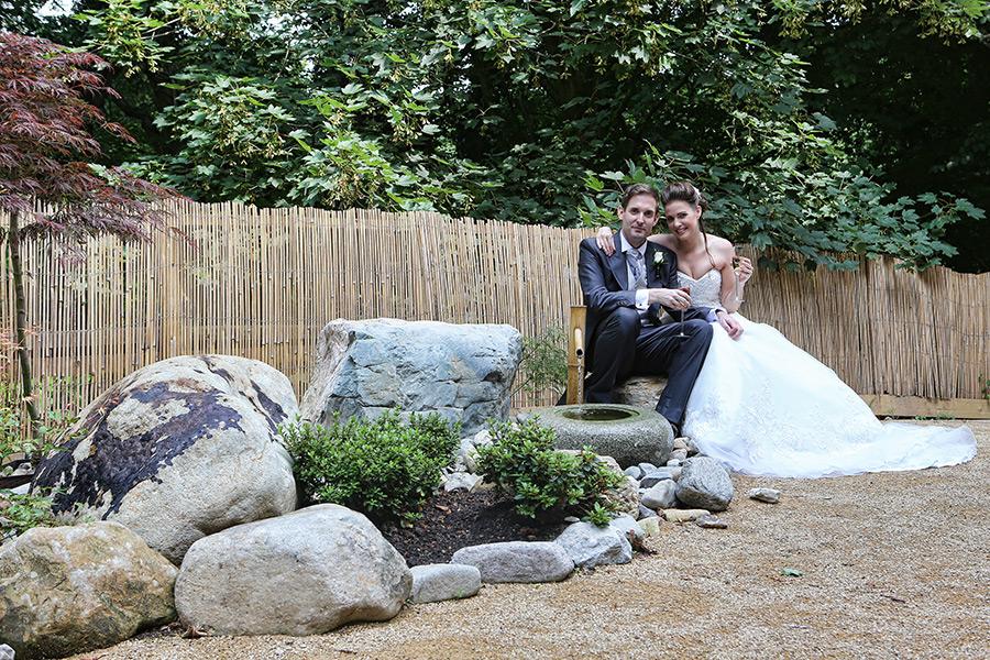 Wedding couple next to japenese garden