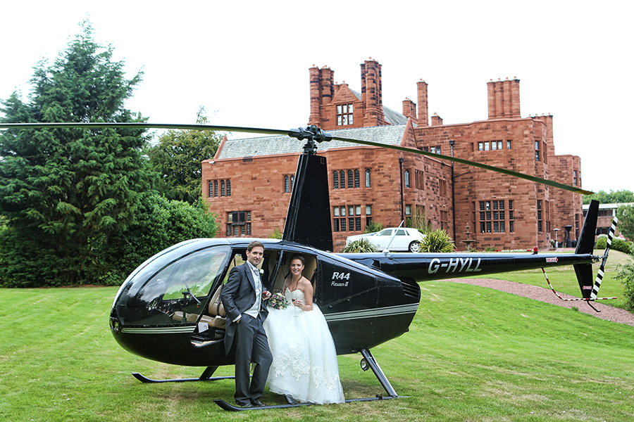Wedding copter in helicopter outside Lake District Wedding venue