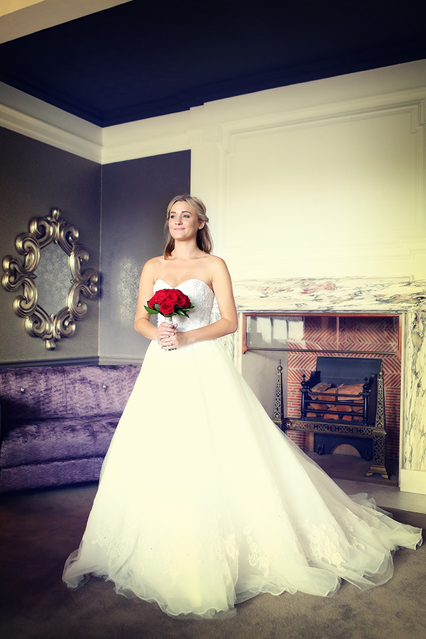 Beautiful Bride standing with red roses