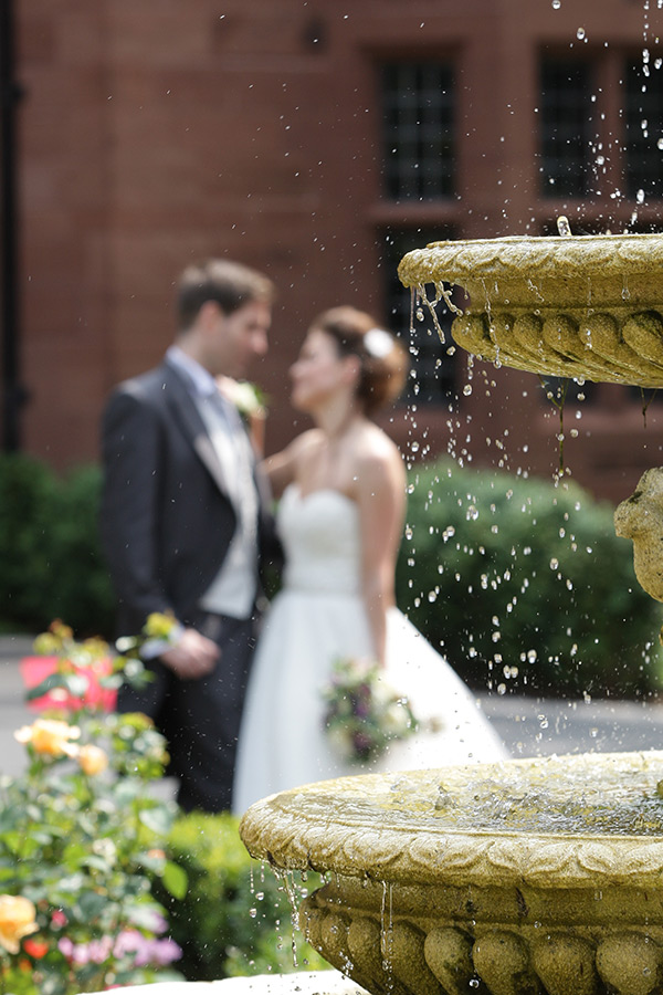 Water fountain with wedding couple behind