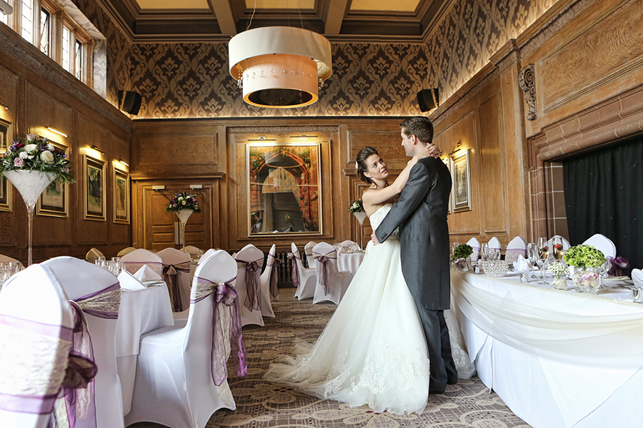 Wedding couple alone in reception room