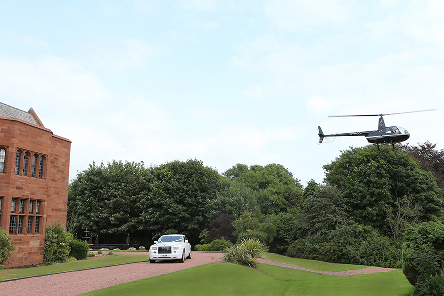 Helicopter landing with wedding car at Abbey House Hotel