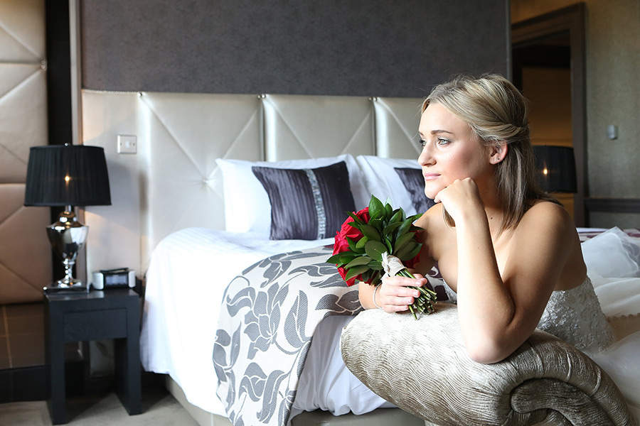 Bride with red rose relaxing in Bridal suite