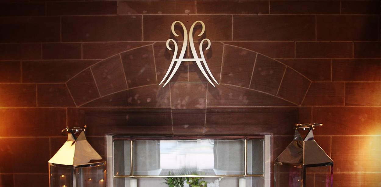 Abbey House hotel logo above lantern lights