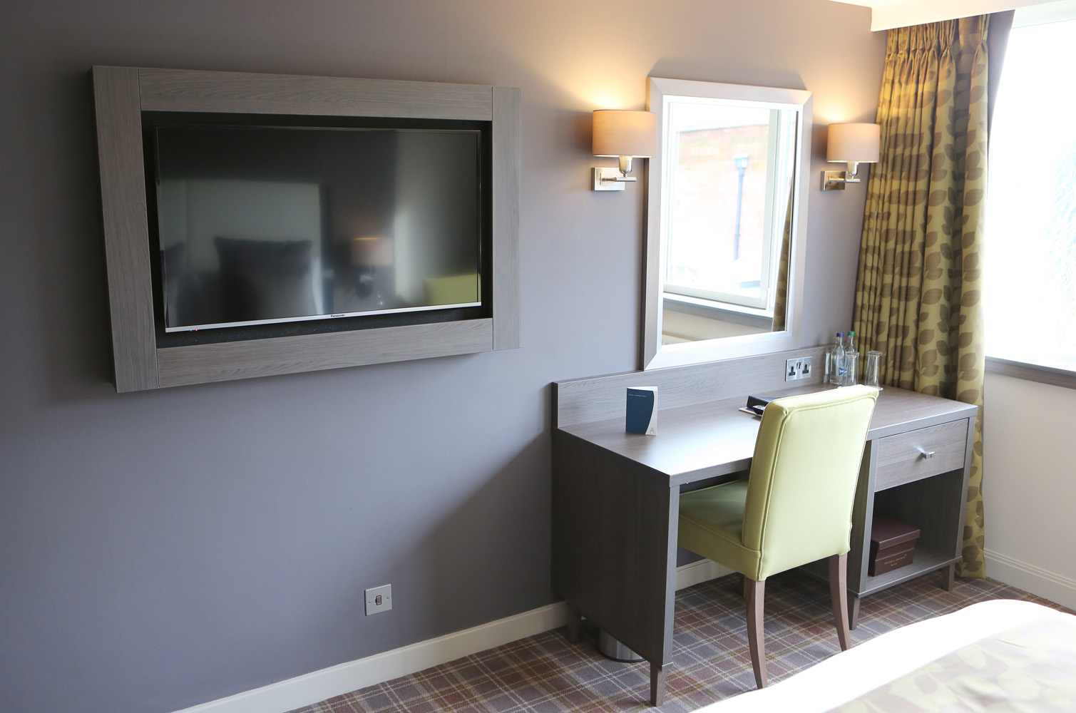 Mirror desk and tv in room