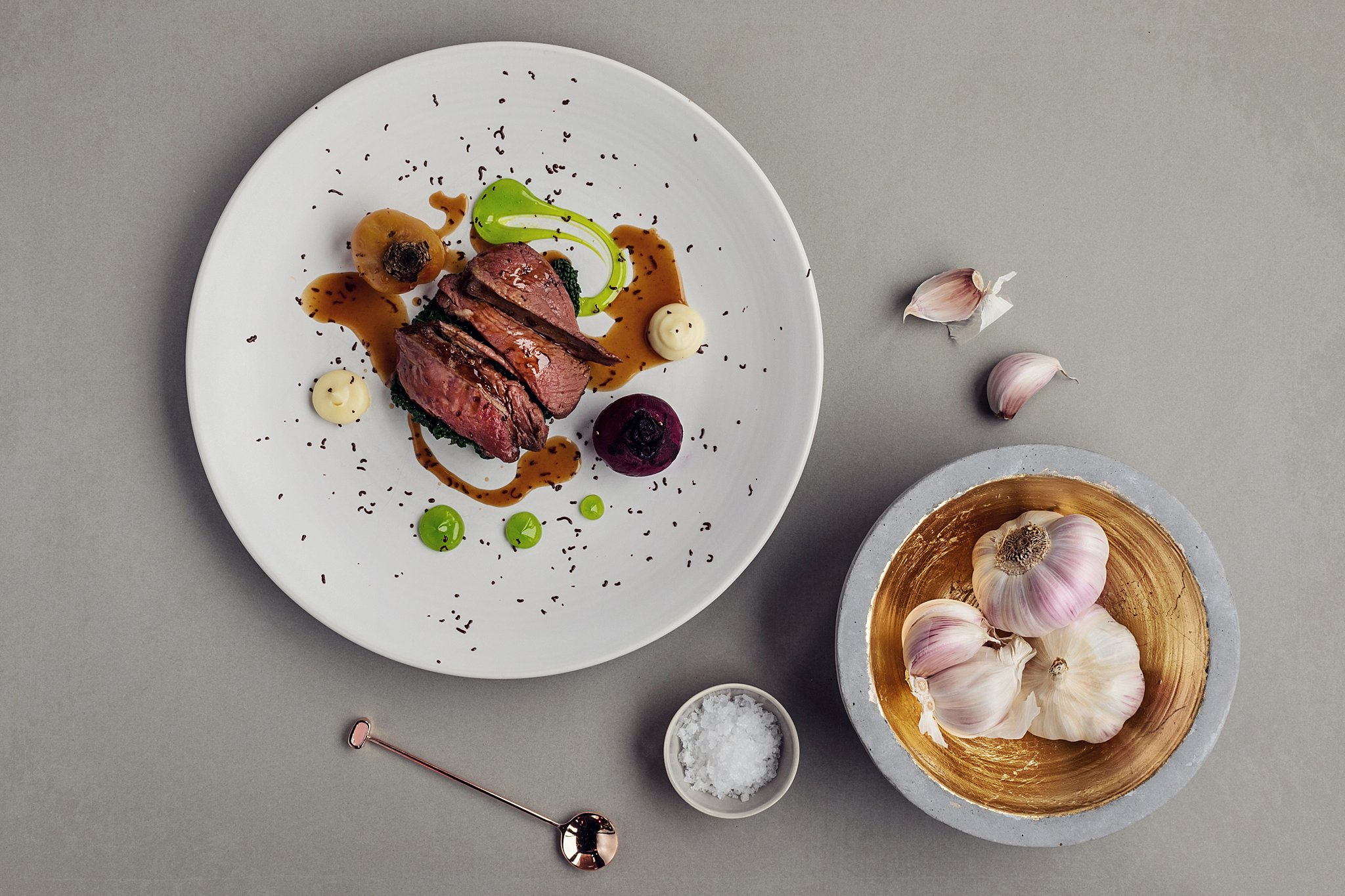 Beef dish with whole clove garlic and rock salt