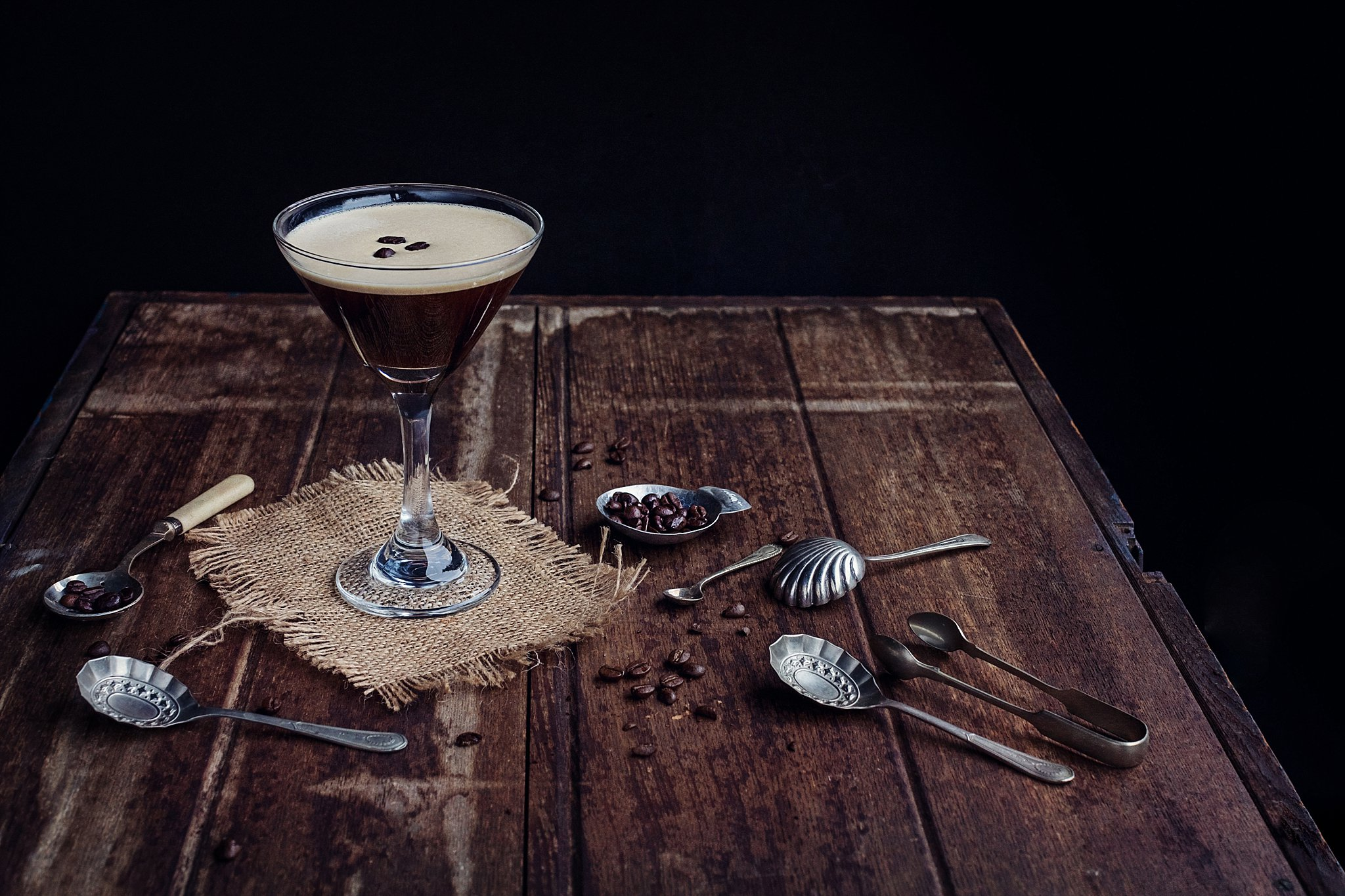 Coffee Martini with coffee beans around