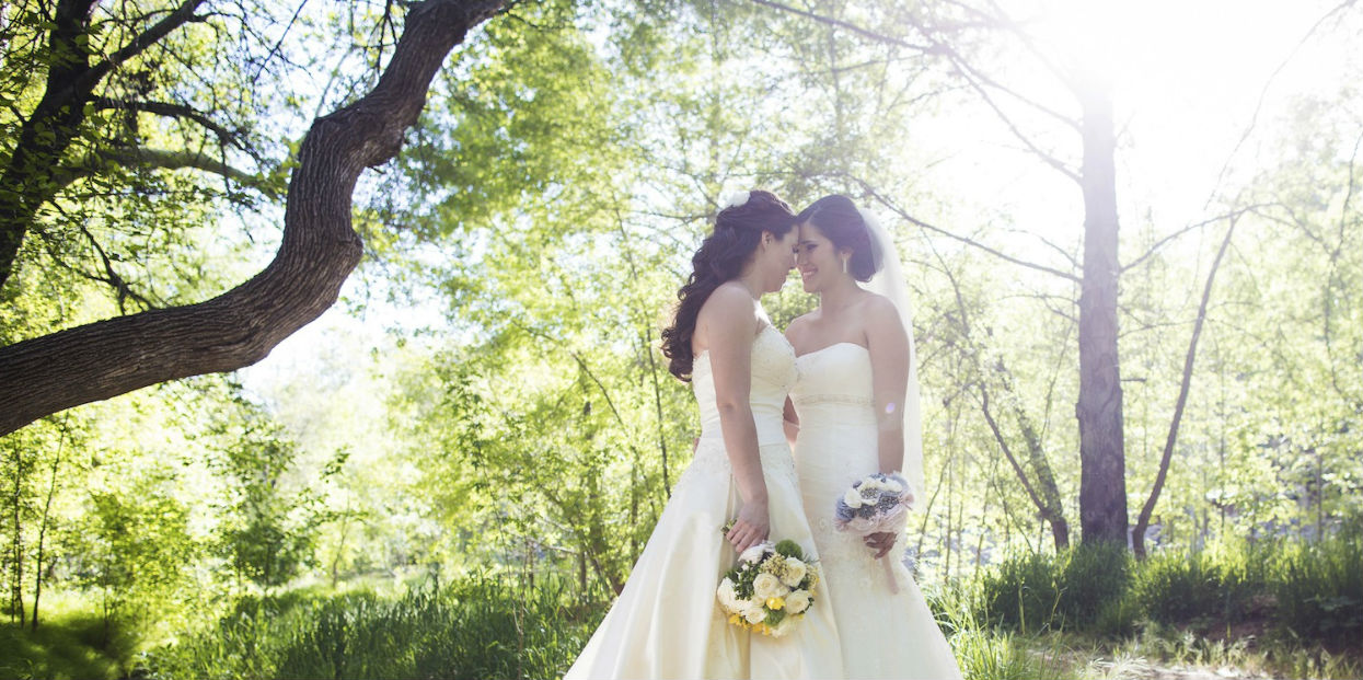 Female wedding couple in the woods
