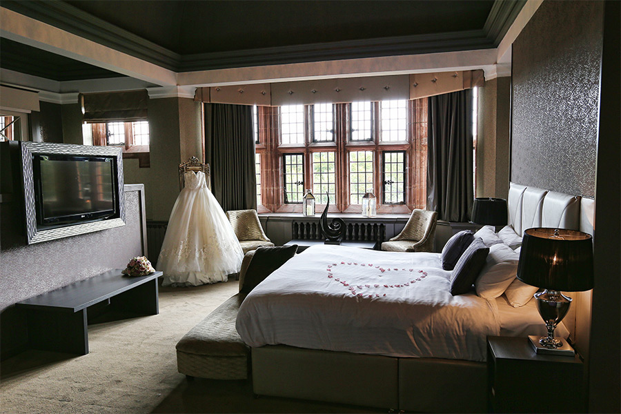Suite with petals on bed