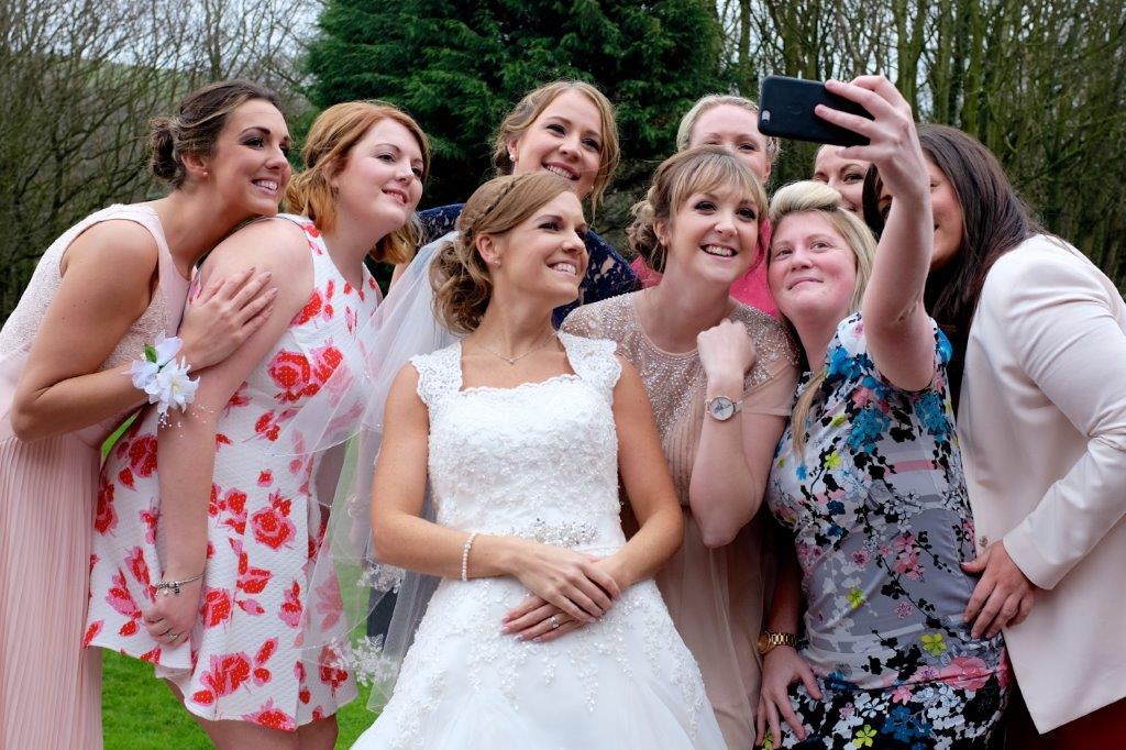 bridal party taking selfie
