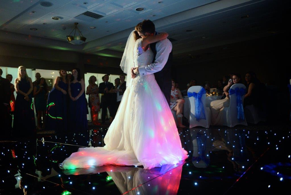 Couple dancing on lit up floor