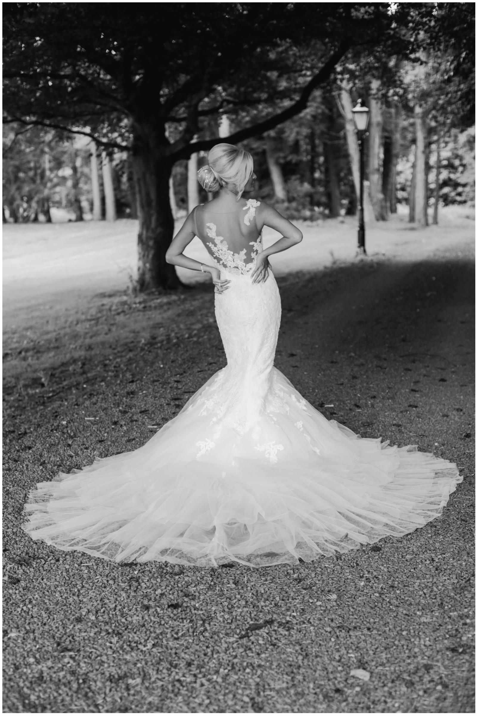 Bride in mermaid wedding dress on outside path