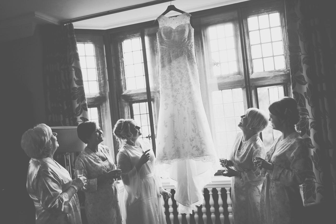 examining the wedding dress
