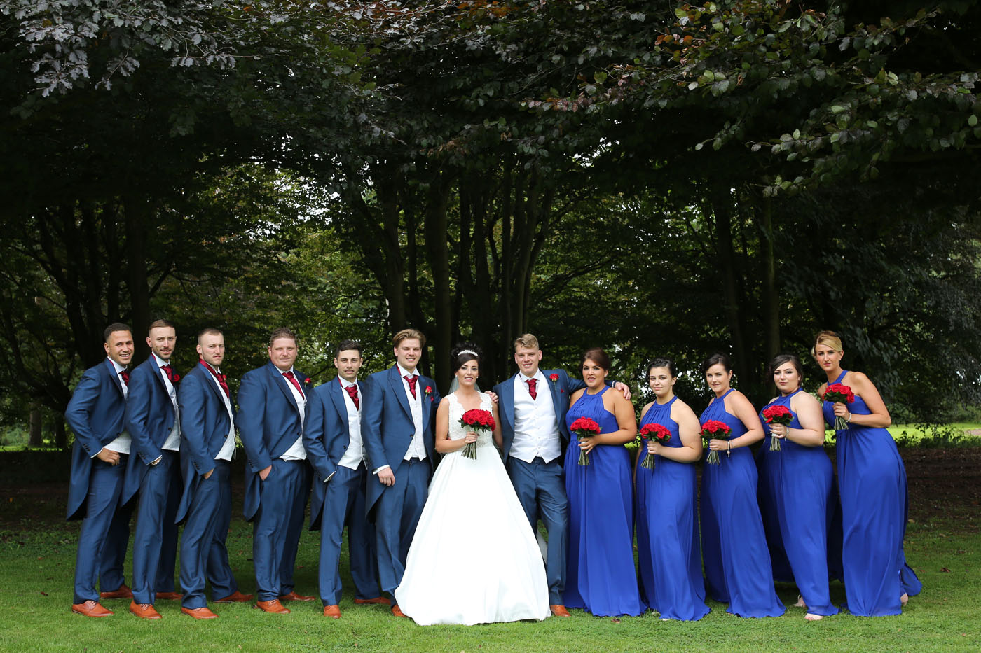 Wedding party wearing blue outside