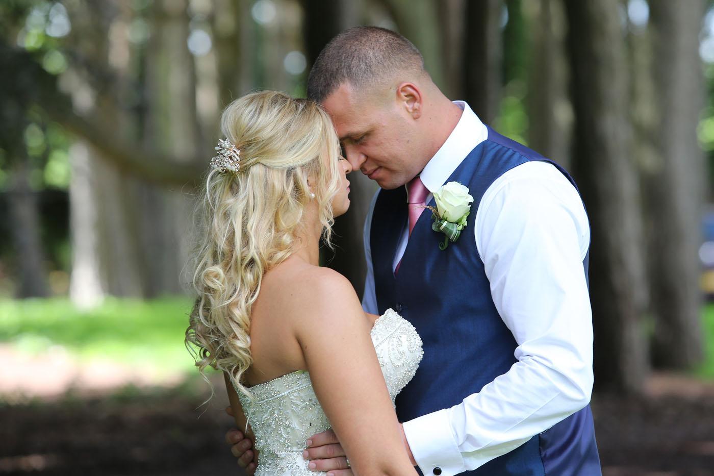 Wedding couple touching foreheads