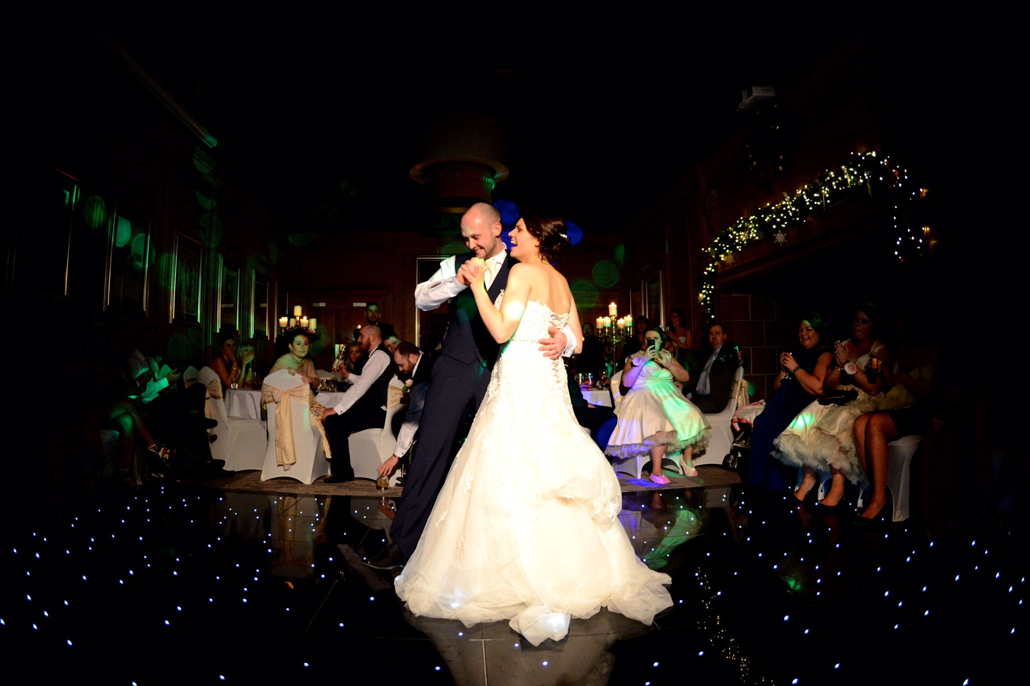 Bride and groom first dance - lit up floor