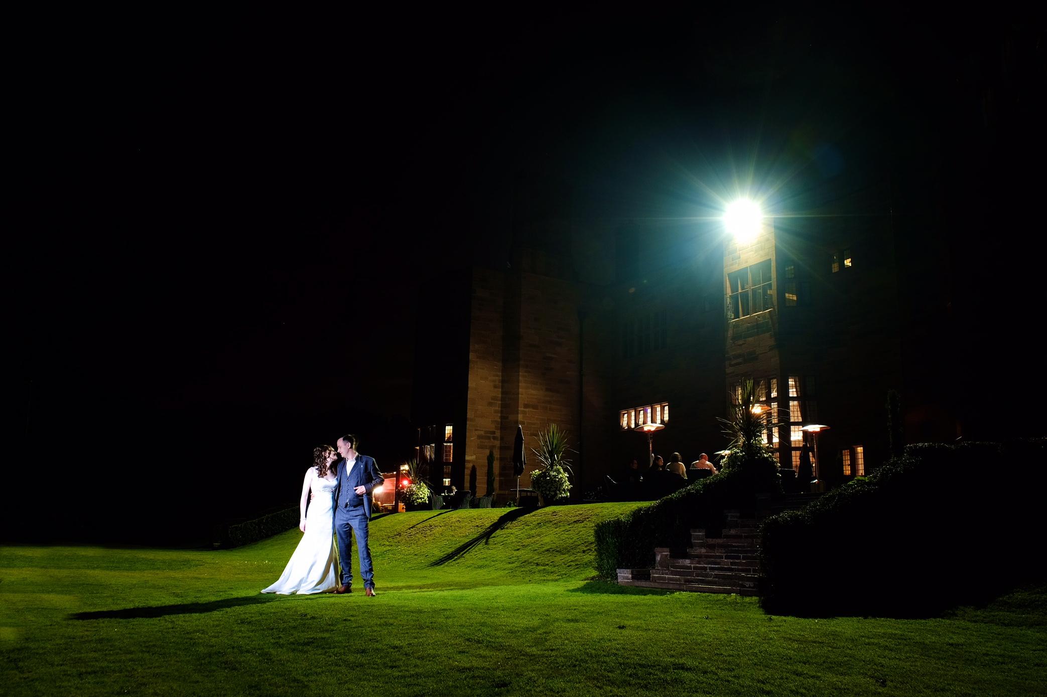 Wedding couple at night under spot light