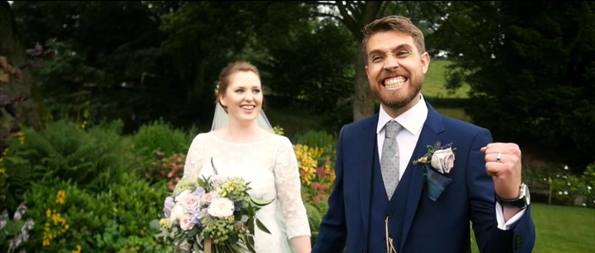 happy groom with bride in background - Adam Wing Cinematographer