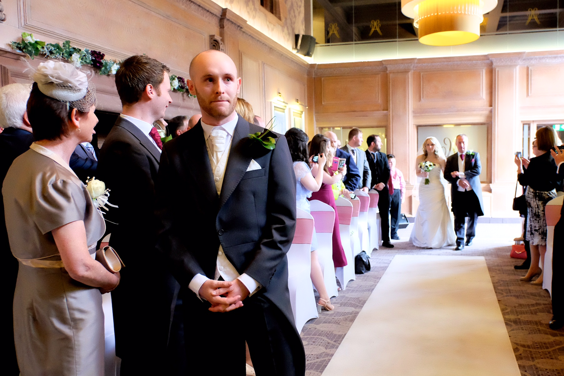 Groom waiting for bride to walk up the isle