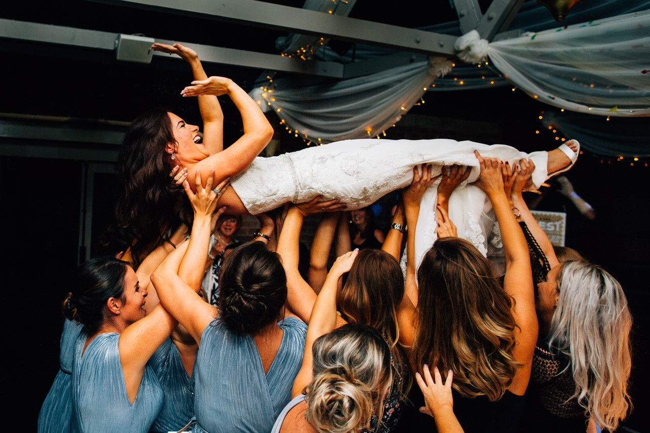 wedding party carrying bride