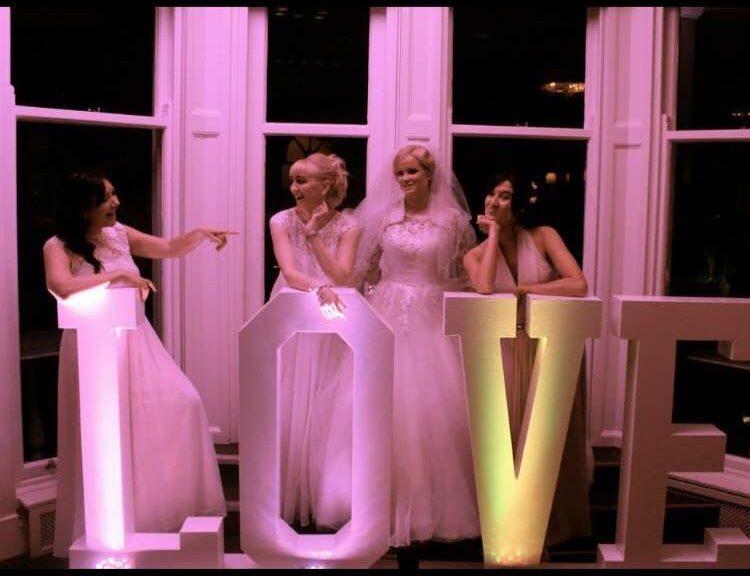 wedding bridesmaids LOVE sign