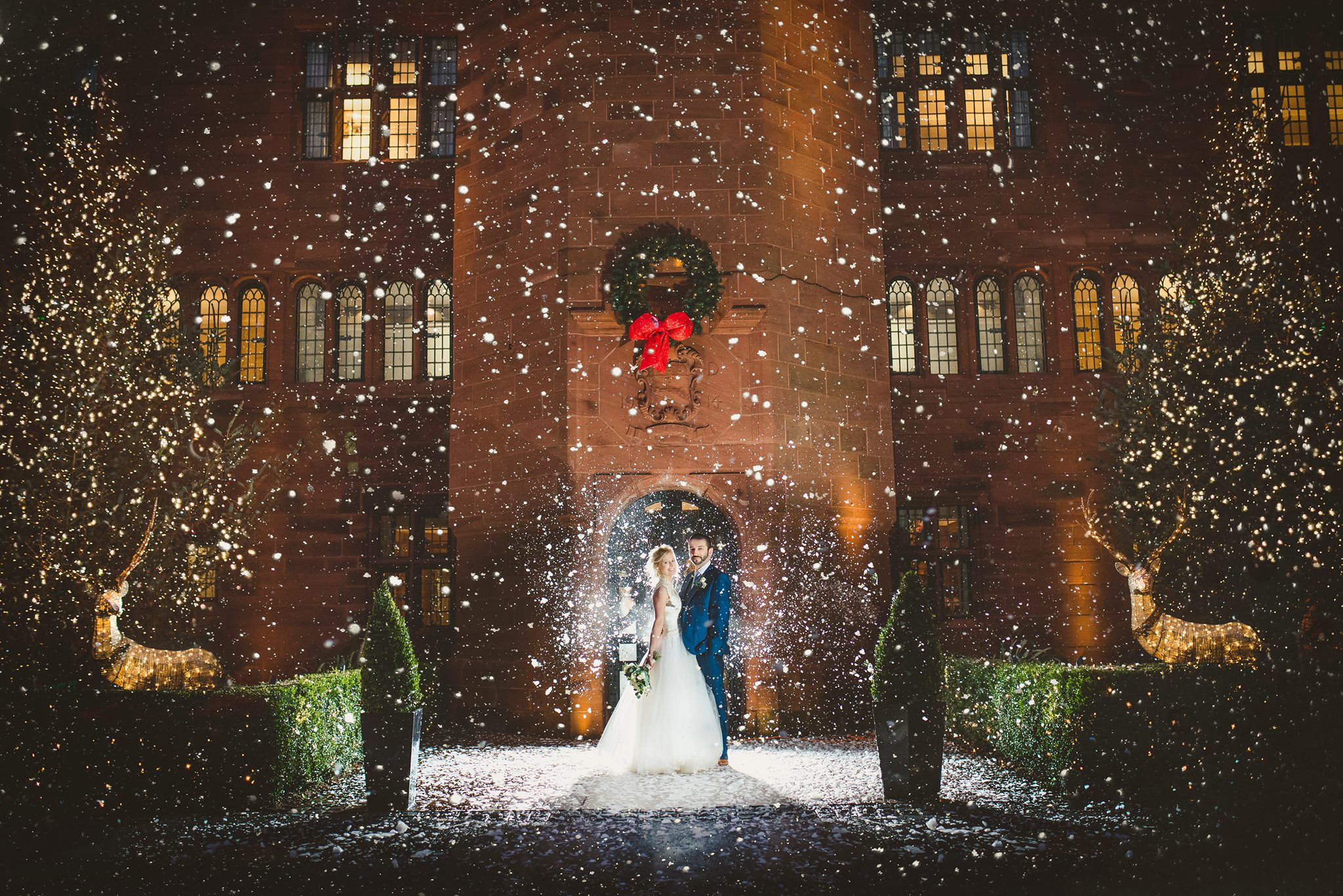 Wedding couple out front in the snow