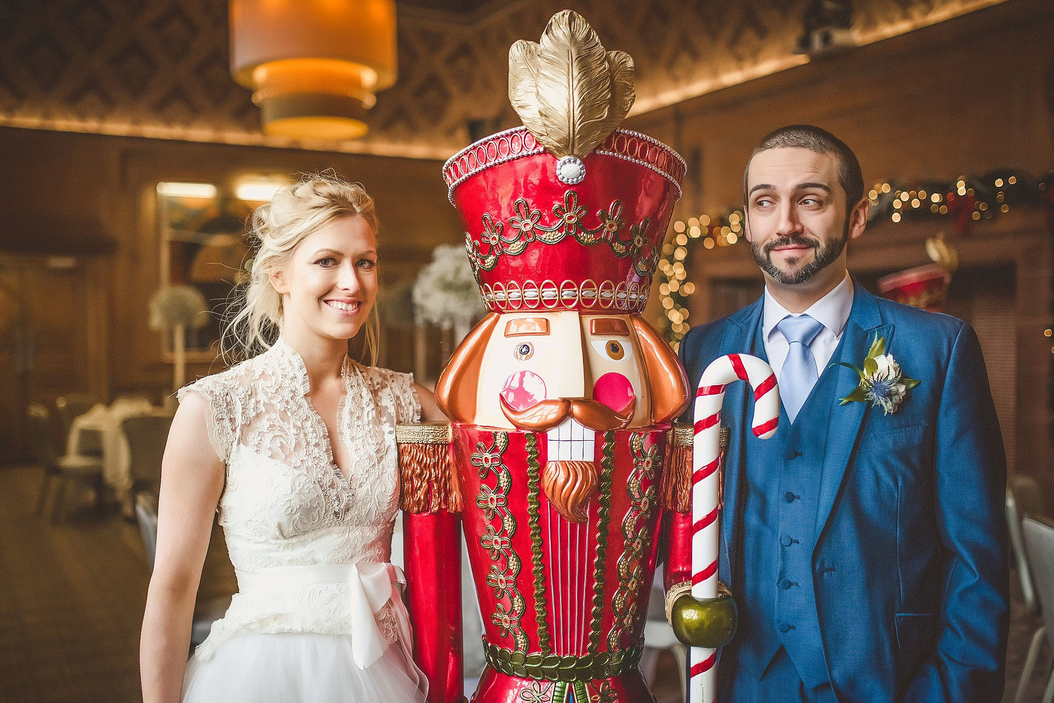 Bride and groom next to giant nutcracker