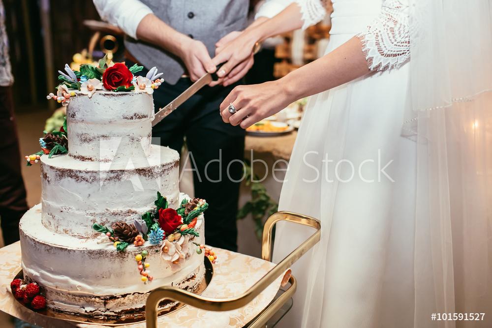 Cutting a wedding cake stock photo