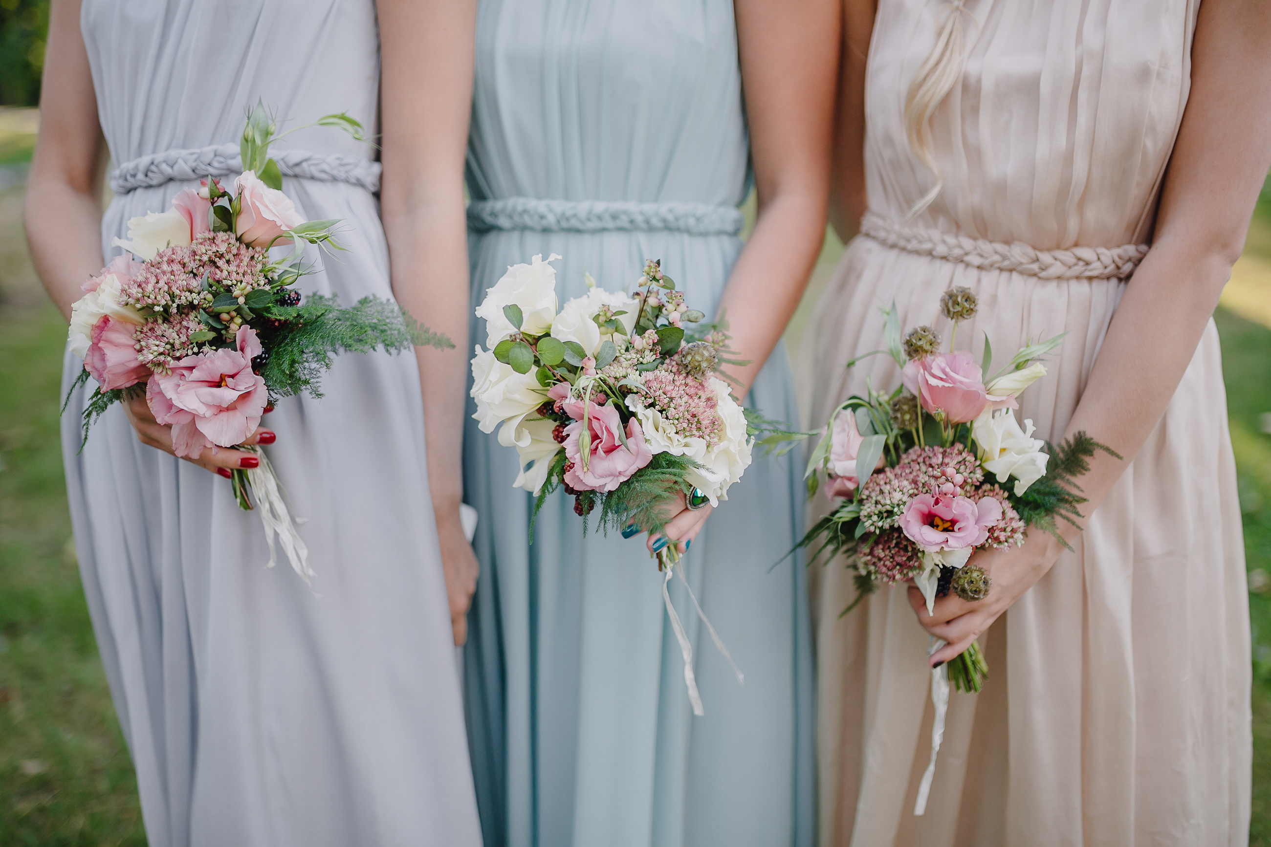 Bridesmaid with floral bouqets