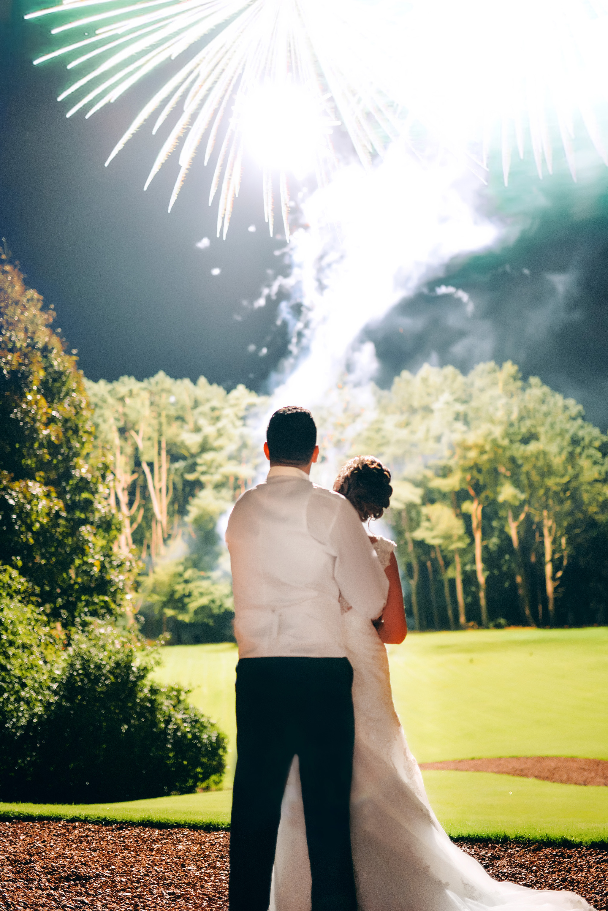 Wedding couple watching fireworks