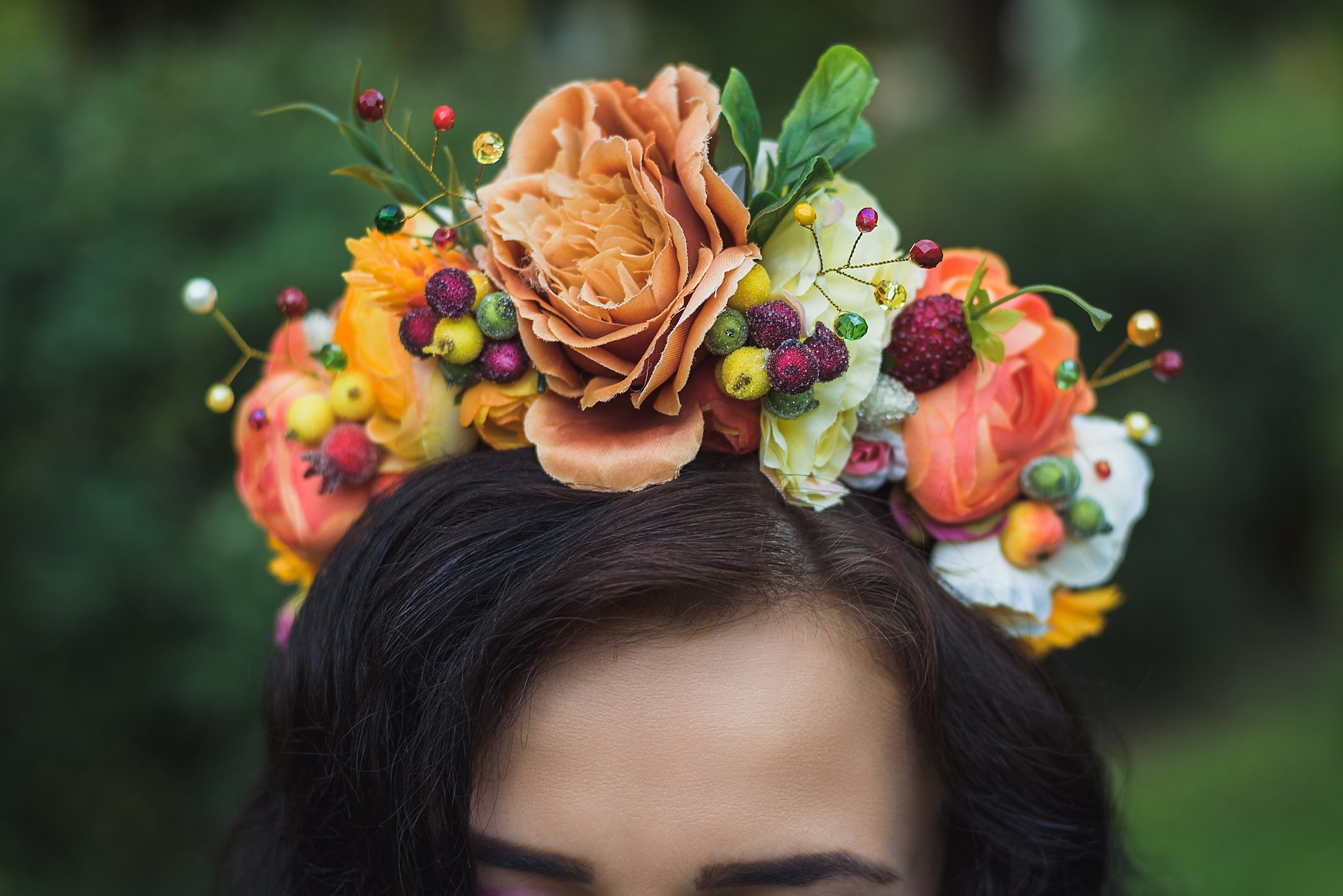 Attractive young woman with orange flowers crown
