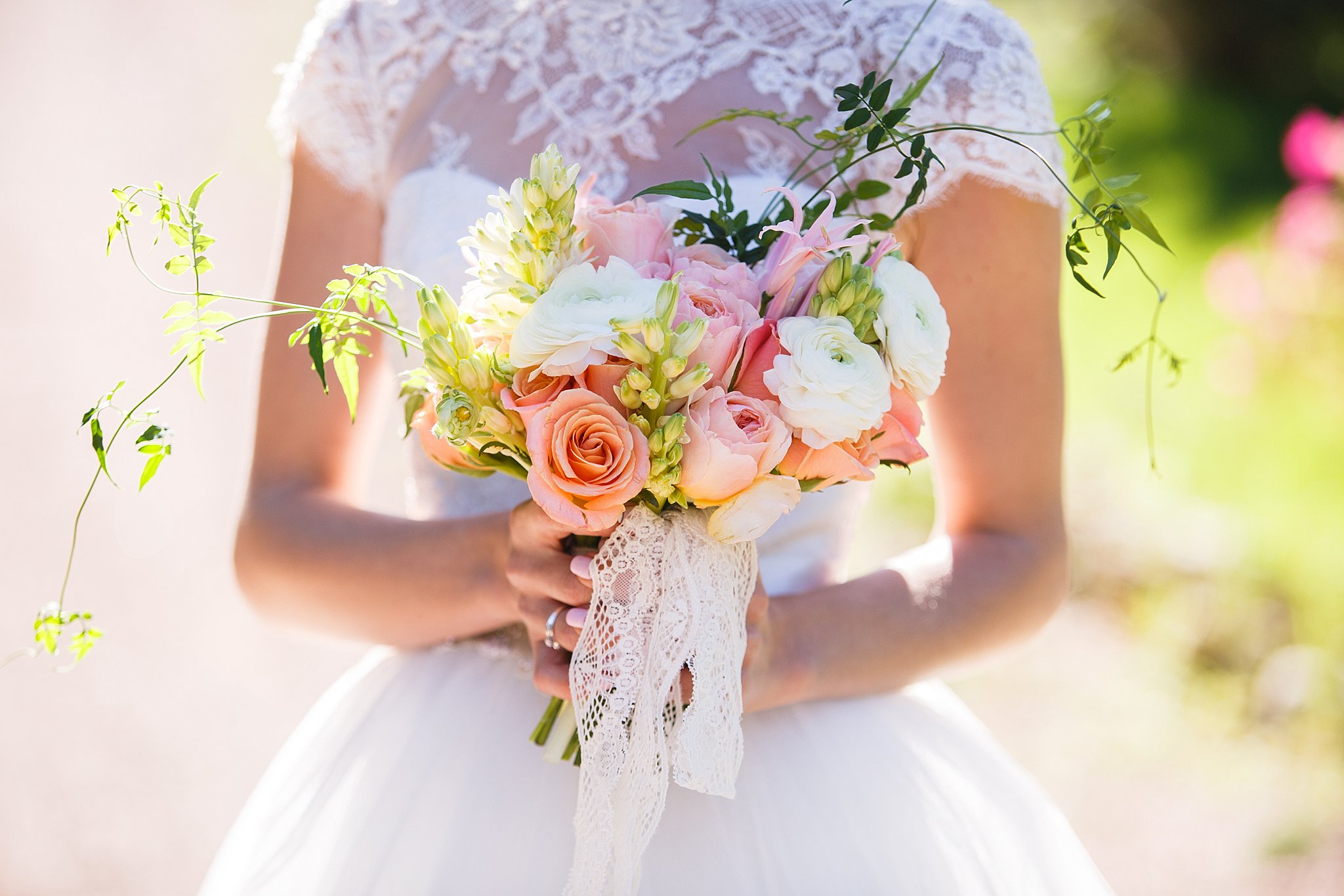 beautiful wedding bouquet in the hands of the bride